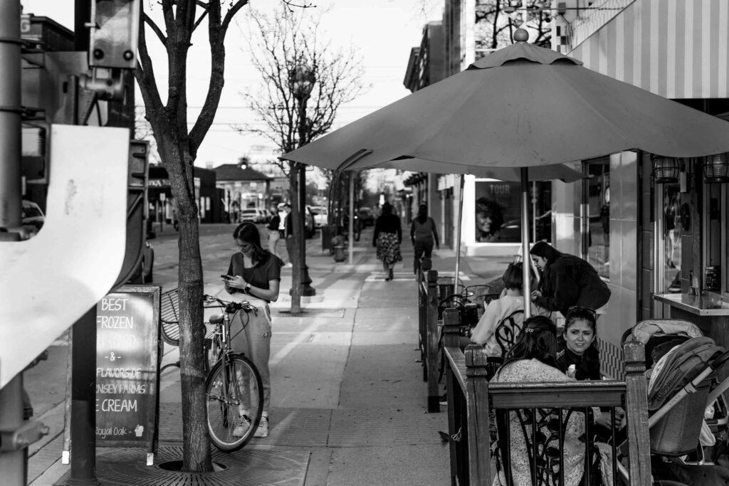 Sidewalk with people in Royal Oak neighborhood